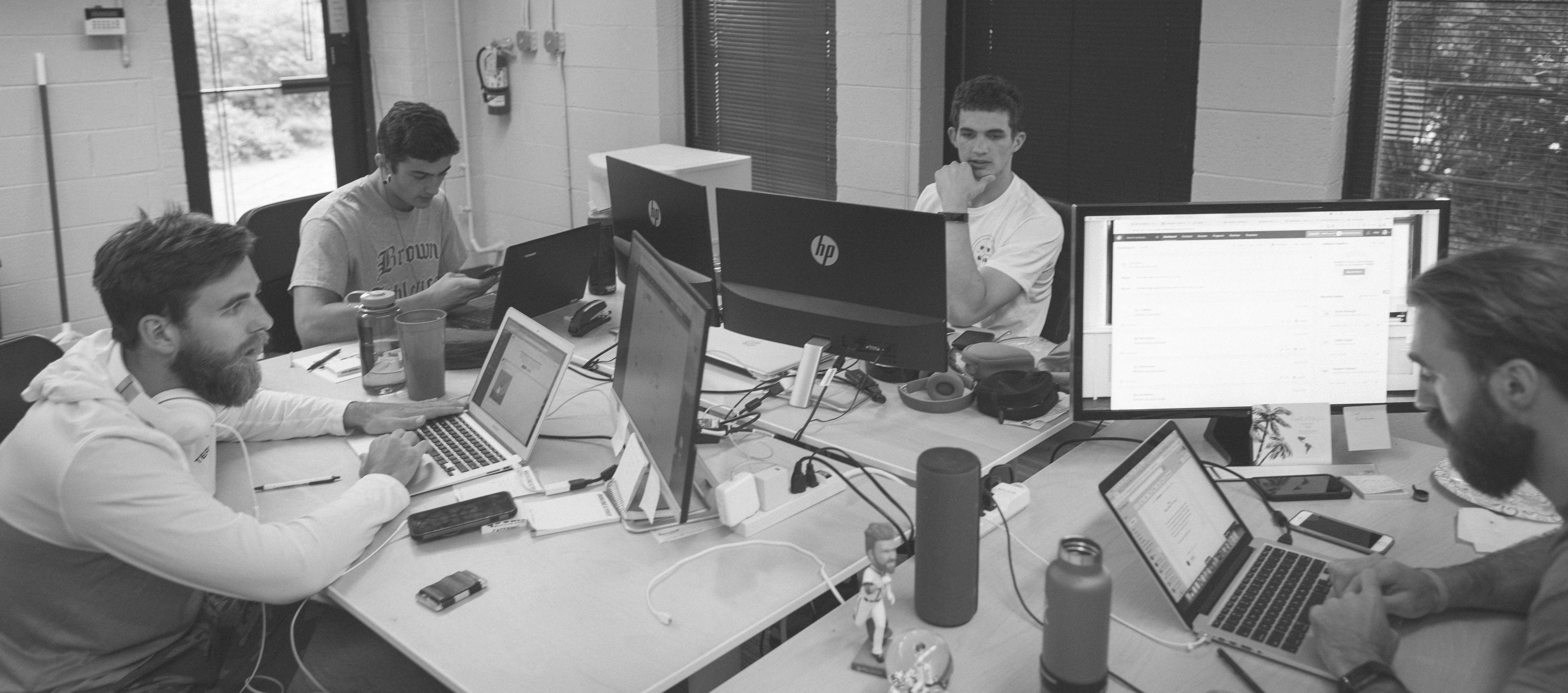 TeamBuildr software team working office